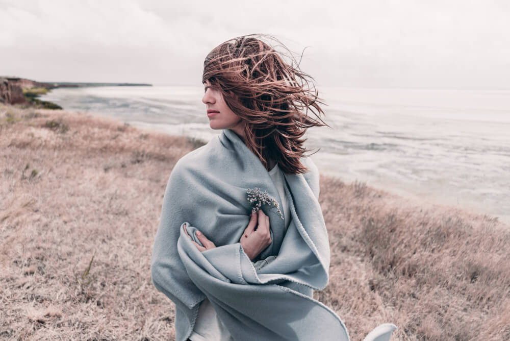 Wind blowing woman's hair outdoors